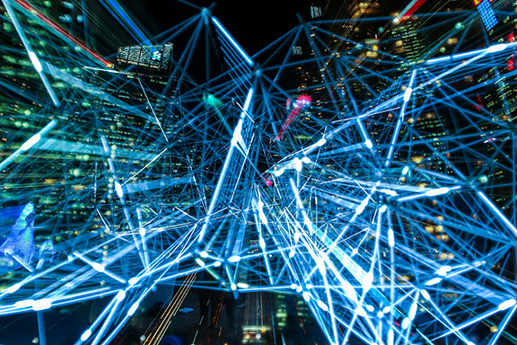 Abstract image of laser lights over office towers